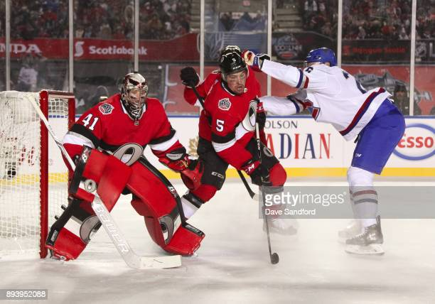 Jeff Petry of the Montreal Canadiens battles for position with Cody Ceci of the Ottawa Senators in front of teammate Craig Anderson during the 2017...