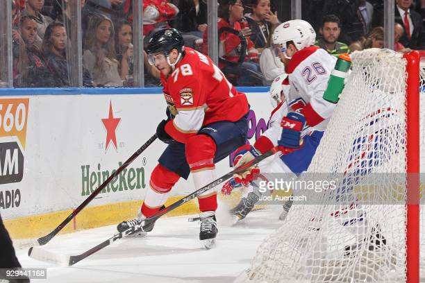 Jeff Petry of the Montreal Canadiens defends against Maxim Mamin of the Florida Panthers as he circles behind the net with the puck during first...