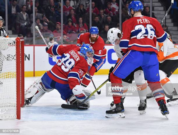 Jeff Petry of the Montreal Canadiens defends against Nolan Patrick of the Philadelphia Flyers in the NHL game at the Bell Centre on February 26 2018...