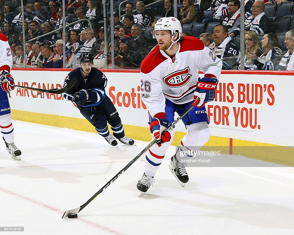 Jeff Petry #26 of the Montreal Canadiens plays the puck as Nic Petan #19 of the Winnipeg Jets gives chase during third period action at the MTS Centre on January 11, 2017 in Winnipeg, Manitoba, Canada.