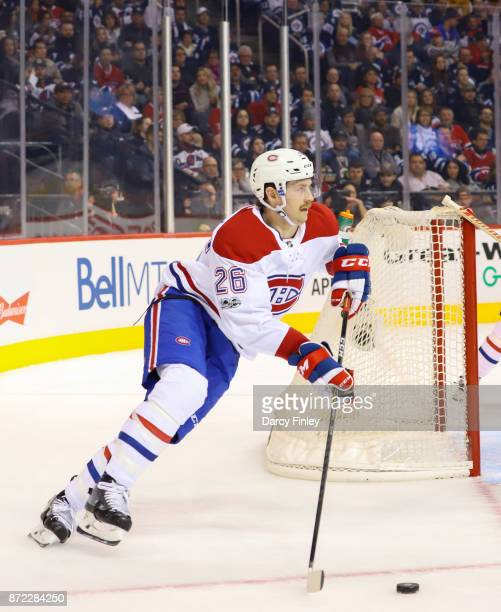 Jeff Petry of the Montreal Canadiens plays the puck up the ice during second period action against the Winnipeg Jets at the Bell MTS Place on...