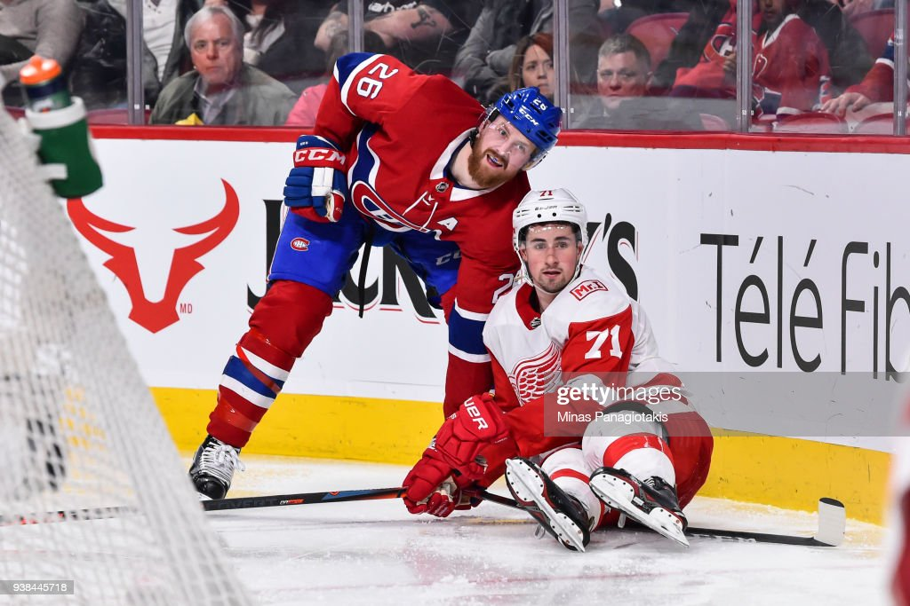 Jeff Petry #26 of the Montreal Canadiens takes down Dylan Larkin #71 of the Detroit Red Wings during the NHL game at the Bell Centre on March 26, 2018 in Montreal, Quebec, Canada. The Montreal Canadiens defeated the Detroit Red Wings 4-2.