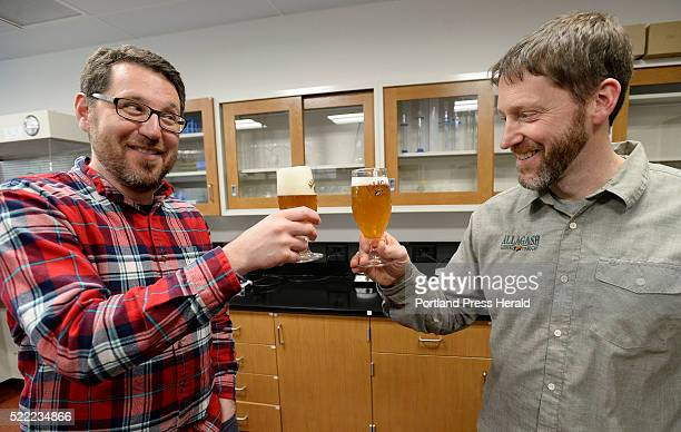 Jeff PilletShore marketing director of Allagash Brewing Company left and brewmaster Jason Perkins celebrate after tasting Sixteen Counties Wednesday...