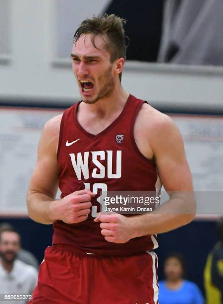 Jeff Pollard of the Washington State Cougars reacts after he was fouled after a basket in the second half of the game against the San Diego State...