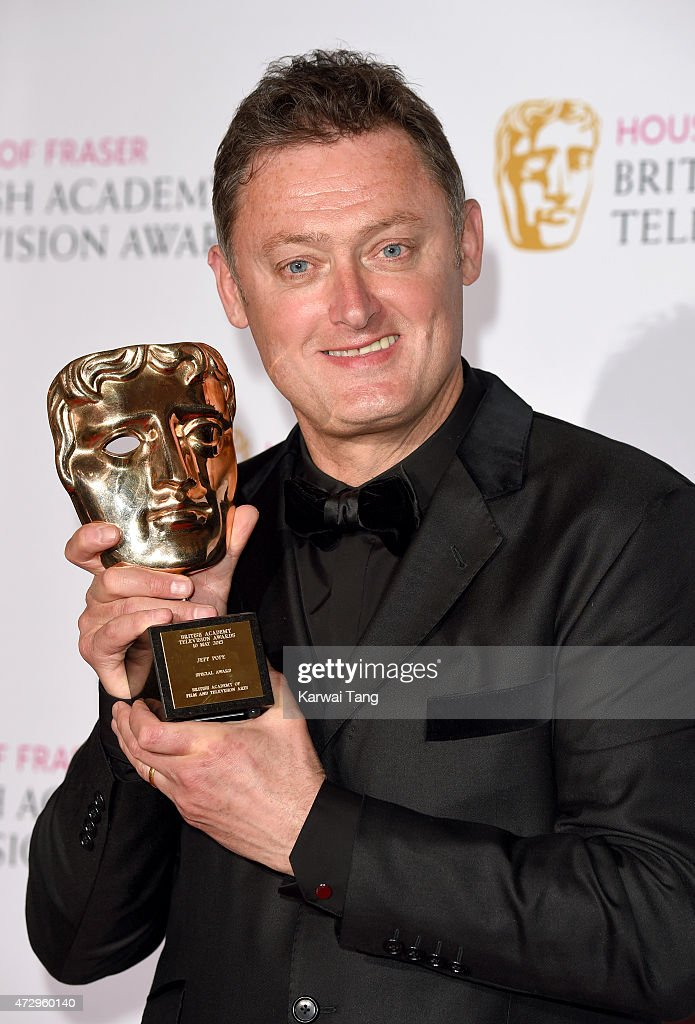 Jeff Pope winner of the Special Award poses in the winners room at the House of Fraser British Academy Television Awards at Theatre Royal on May 10, 2015 in London, England.