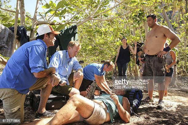 Jeff Probst Dr Joe and Bret LaBelle assess Paul Wachter's condition on the second episode of SURVIVOR Millennials vs Gen X airing Wednesday Sept 28...
