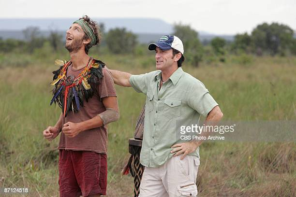 Jeff Probst puts the immunity necklace on Stephen Fishbach as he celebrates his victory during the immunity challenge 'Propellerheads' during the...