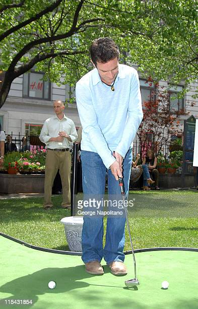 Jeff Probst works on his golf game at New York Herald's Square as he helps to launch The Home Depot and MasterCard $100000 Backyard Retreat...