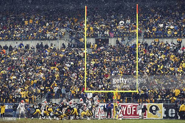 Jeff Reed of the Pittsburgh Steelers kicks an extra point against the Cleveland Browns as it snows during the AFC Wild Card game on January 5 2002 at...