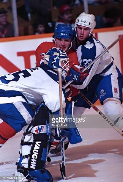 Jeff Reese and Al Iafrate of the Toronto Maple Leafs skate against Claude Lemieux of the Montreal Canadiens during NHL game action on January 27 1990...