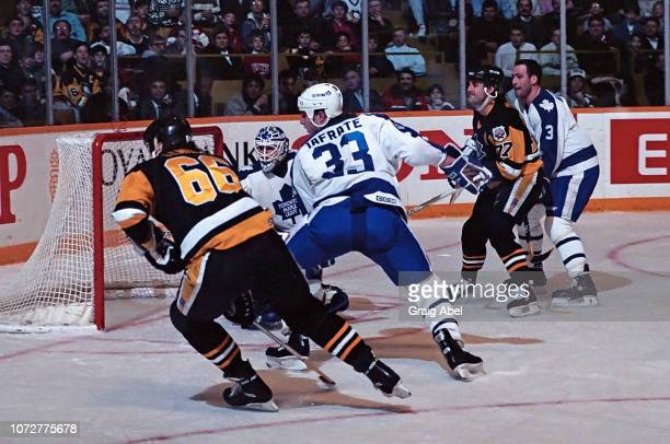 Jeff Reese Brad Marsh and Al Iafrate of the Toronto Maple Leafs skate against Mario Lemieux and Paul Coffey of the Pittsburgh Penguins during NHL...