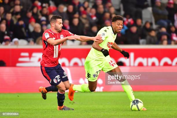 Jeff Reine Adelaide of Angers and Thiago Maia of Lille during the Ligue 1 match between Lille OSC and Angers SCO at Stade Pierre Mauroy on February...