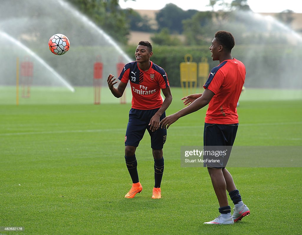 Jeff Reine-Adelaide and Alex Iwobi of Arsenal during a training session at London Colney on August 1, 2015 in St Albans, England.