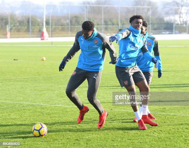 Jeff ReineAdelaide and Alex Iwobi of Arsenal during a training session at London Colney on December 12 2017 in St Albans England