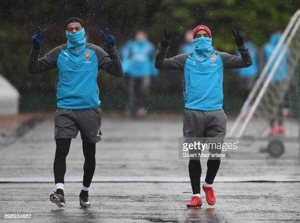 Jeff ReineAdelaide and Alex Lacazette of Arsenal before a training session at London Colney on December 27 2017 in St Albans England