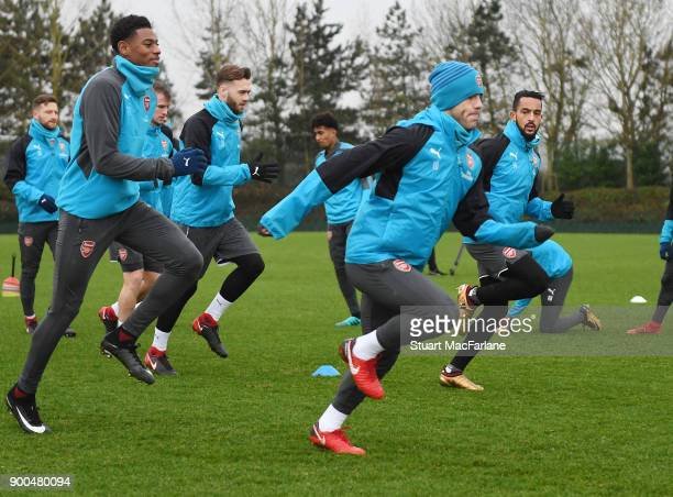 Jeff ReineAdelaide and Jack Wilshere of Arsenal during a training session at London Colney on January 2 2018 in St Albans England