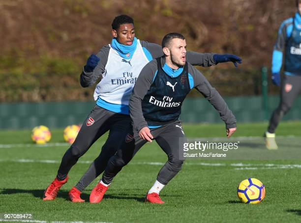 Jeff ReineAdelaide and Jack Wilshere of Arsenal during a training session at London Colney on January 19 2018 in St Albans England