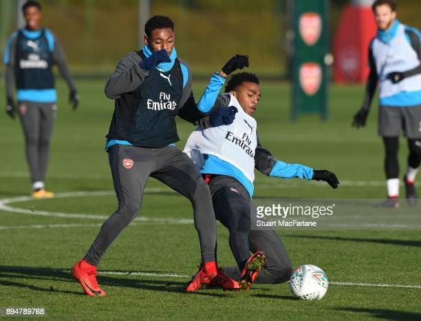 Jeff ReineAdelaide and Joe Willock of Arsenal during a training session at London Colney on December 18 2017 in St Albans England