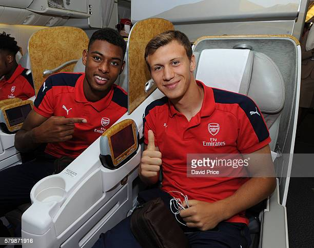 Jeff ReineAdelaide and Krystian Bielik of Arsenal on the plane at Stansted Airport on July 25 2016 in London England