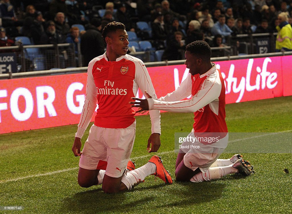Jeff Reine-Adelaide celebrates scoring a goal for Arsenal with Stephy Mavididi during the match between Manchester City and Arsenal in the FA Youth Cup semi final 1st leg on March 18, 2016 in Manchester, England.