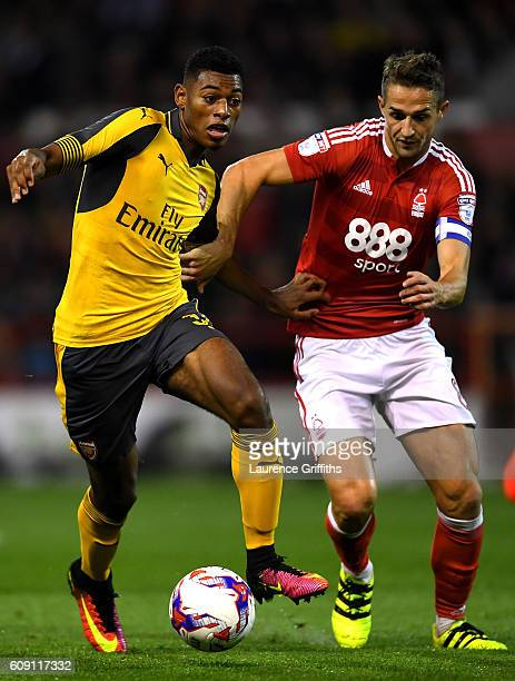 Jeff ReineAdelaide of Arsenal and Chris Cohen of Nottingham Forest in action during the EFL Cup Third Round match between Nottingham Forest and...