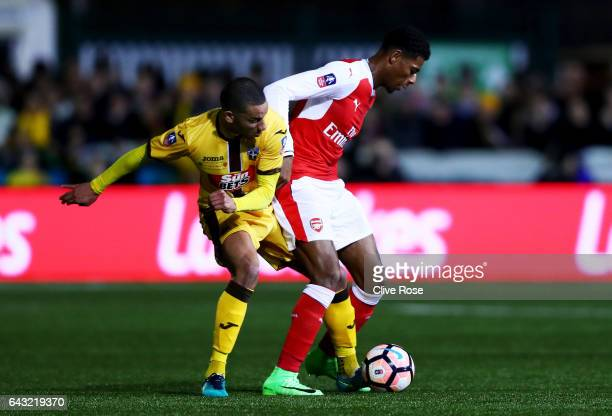 Jeff ReineAdelaide of Arsenal battles for the ball with Craig Eastmond of Sutton United during the Emirates FA Cup fifth round match between Sutton...
