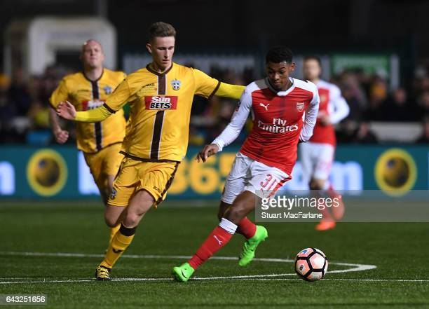 Jeff ReineAdelaide of Arsenal breaks past Adam May of Sutton during the Emirates FA Cup Fifth Round match between Sutton United and Arsenal on...
