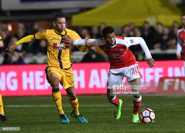 Jeff ReineAdelaide of Arsenal breaks past Craig Eastmond of Sutton during the Emirates FA Cup Fifth Round match between Sutton United and Arsenal on...