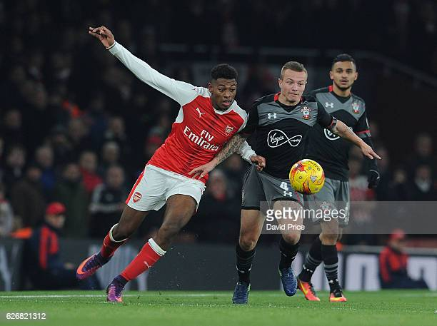Jeff ReineAdelaide of Arsenal challenges Jordy Clasie of Southampton during the EFL League Cup match between Arsenal and Southampton at Emirates...
