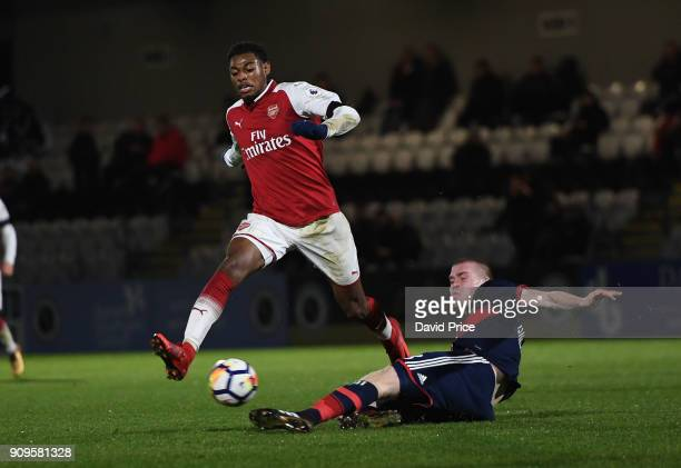 Jeff ReineAdelaide of Arsenal is challegned by Thomas Isherwood of Bayern during the Premier League International Cup Match between Arsenal and...
