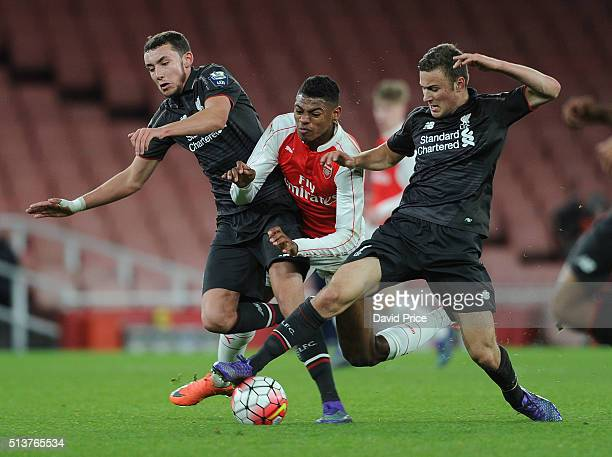 Jeff ReineAdelaide of Arsenal is challenged by Kris Owens and Herbie Kane of Liverpool during the match between Arsenal U18 and Liverpool U18 in the...