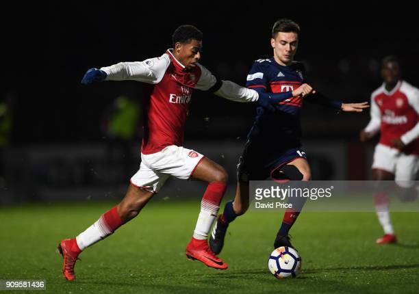 Jeff ReineAdelaide of Arsenal is challenged by Milos Pantovic of Bayern during the Premier League International Cup Match between Arsenal and Bayern...