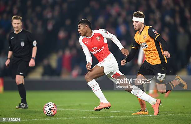 Jeff ReineAdelaide of Arsenal is challenged by Nick Powell of Hull City during the Emirates FA Cup Fifth Round Replay match between Hull City and...