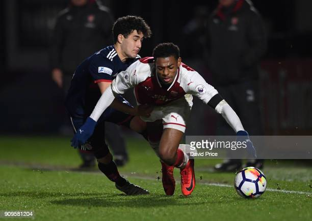 Jeff ReineAdelaide of Arsenal is fouled by Resul Turkkalesi of Bayern during the Premier League International Cup Match between Arsenal and Bayern...