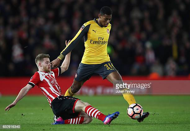 Jeff ReineAdelaide of Arsenal is tackled by Jack Stephens of Southampton during the Emirates FA Cup Fourth Round match between Southampton and...