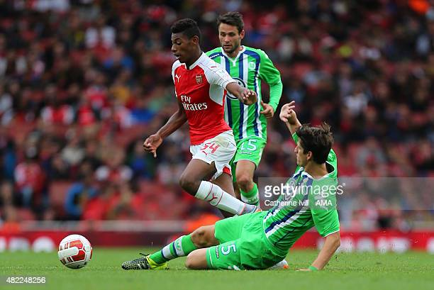 Jeff ReineAdelaide of Arsenal is tackled by Timm Klose of Wolfsburg during the Emirates Cup match between Arsenal and VfL Wolfsburg at Emirates...
