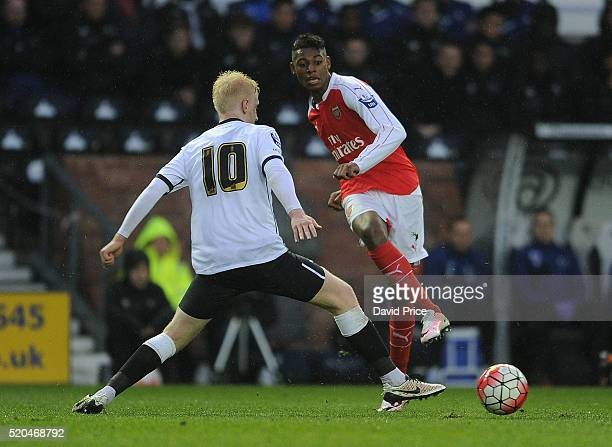 Jeff ReineAdelaide of Arsenal passes the ball under pressure from Will Hughes of Derby during the Barclays U21 Premier League match between Derby...