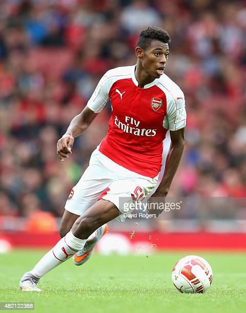 Jeff ReineAdelaide of Arsenal runs with the ball during the Emirates Cup match between Arsenal and VfL Wolfsburg at the Emirates Stadium on July 26...