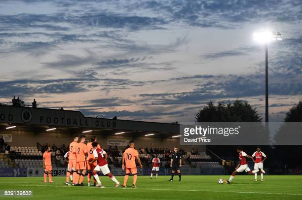 Jeff ReineAdelaide of Arsenal takes a free kick during the match between Arsenal and Liverpool at Meadow Park on August 25 2017 in Borehamwood England