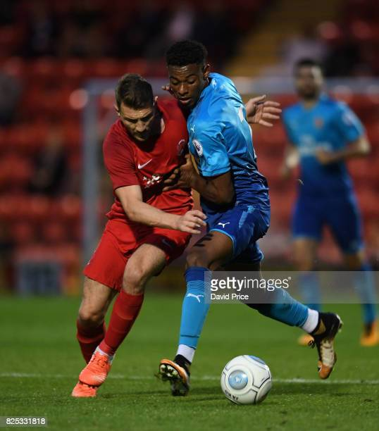 Jeff ReineAdelaide of Arsenal takes on Craig Clay of Leyton Orient during the match between Leyton Orient and Arsenal U23 at Brisbane Road on August...