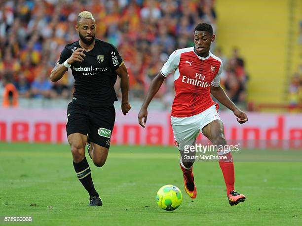 Jeff ReineAdelaide of Arsenal takes on John Bostock of Lens during a pre season friendly between RC Lens and Arsenal at Stade BollaertDelelis on July...