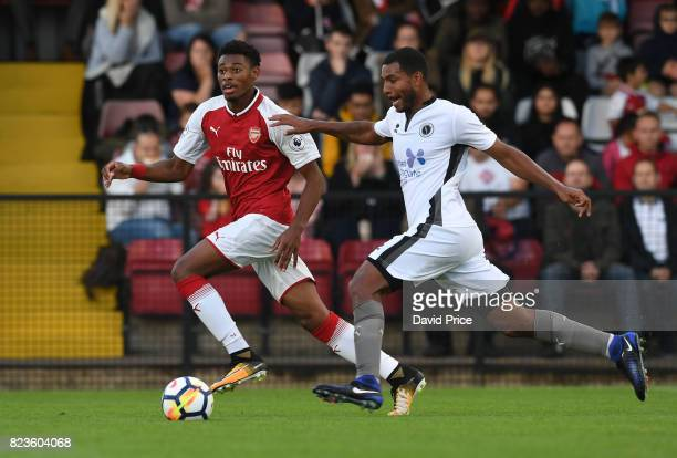 Jeff ReineAdelaide of Arsenal takes on Kieran Murtagh of Boreham Wood during the match between Boreham Wood and Arsenal XI at Meadow Park on July 27...
