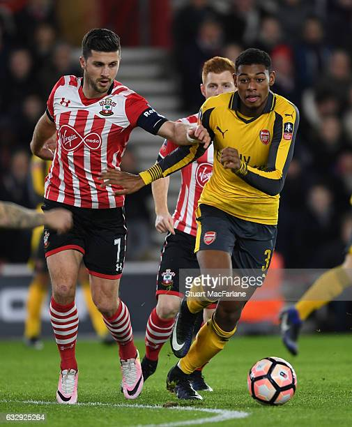 Jeff ReineAdelaide of Arsenal takes on Shane Long of Southampton during the Emirates FA Cup Fourth Round match between Southampton and Arsenal at St...