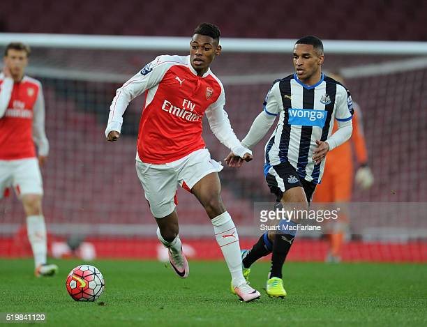 Jeff ReineAdelaide of Arsenal takes on Sylvain Marveaux of Newcastle during the Barclays Premier League match between Arsenal and Newcastle United at...