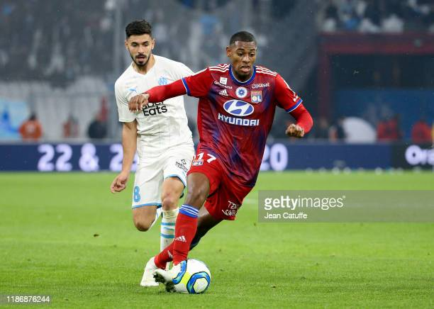 Jeff Reine-Adelaide of Lyon, Morgan Sanson of Marseille during the Ligue 1 match between Olympique de Marseille and Olympique Lyonnais at Stade...