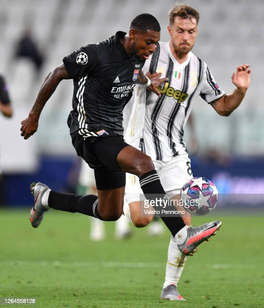 Jeff Reine-Adelaide of Olympique Lyon is challenged by Aaron Ramsey of Juventus during the UEFA Champions League round of 16 second leg match between...
