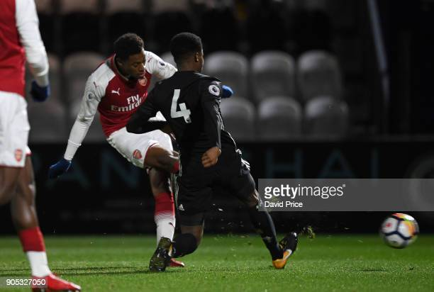 Jeff ReineAdelaide scores Arsenal's 1st goal under pressure from Tyrell Warren of Man Utd during the Premier League 2 match between Arsenal and...