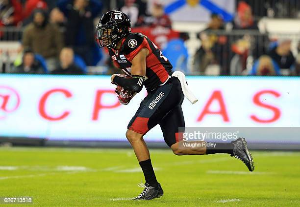 Jeff Richards of the Ottawa Redblacks runs with the ball after making an interception during the first half of the 104th Grey Cup Championship Game...