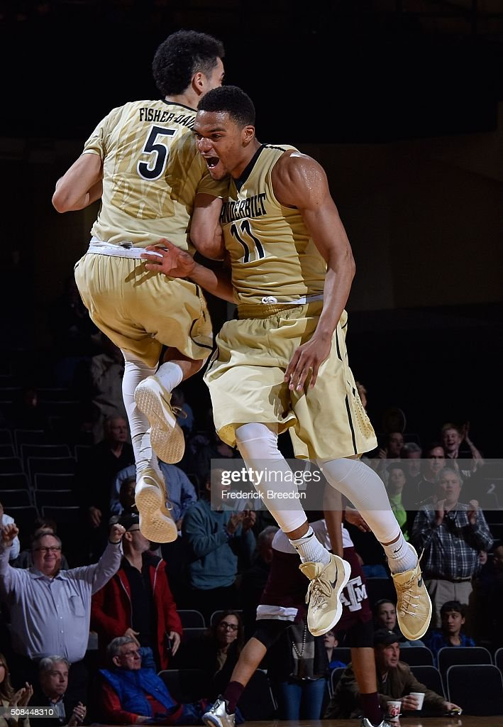 Jeff Roberson #11 of the Vanderbilt Commodores bounces off teammate Matthew Fisher Davis #5 during the second half of a 77-60 Vanderbilt upset of Texas A&M at Memorial Gym on February 4, 2016 in Nashville, Tennessee.
