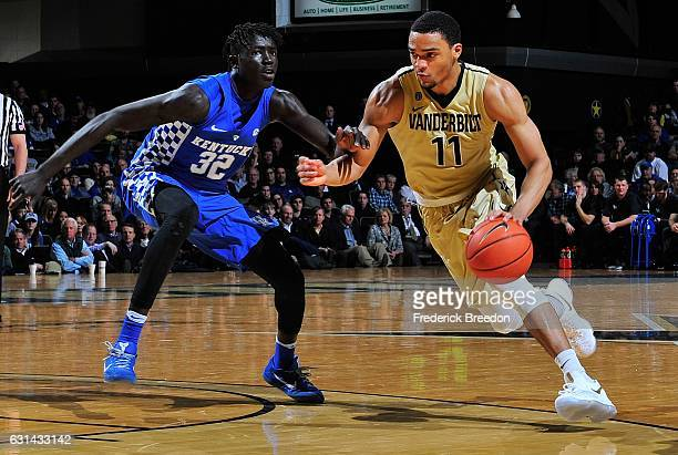 Jeff Roberson of the Vanderbilt Commodores dribbles against Mychal Mulder of the Kentucky Wildcats during the second half at Memorial Gym on January...